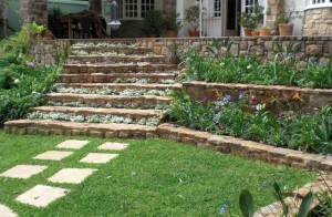 Natural stone cladding with informal planting