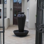 Formal water feature in courtyard